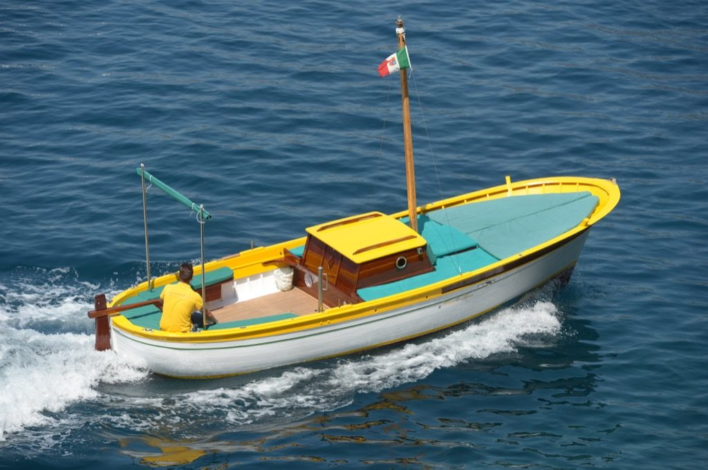 Traditional gozzo boat S. Luca view from above in open sea
