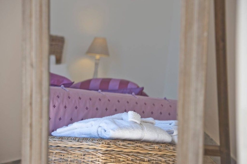 Casa Coccinella interior bedroom and towel for guests