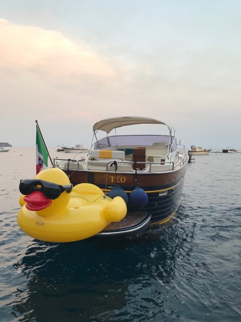 The modern gozzo boat with a yellow duck on the sea