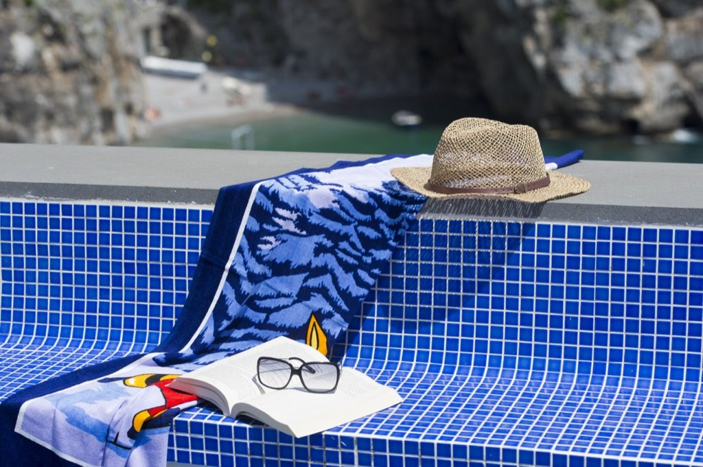 Suite Terramare Terrace with beach towel hat book and glasses