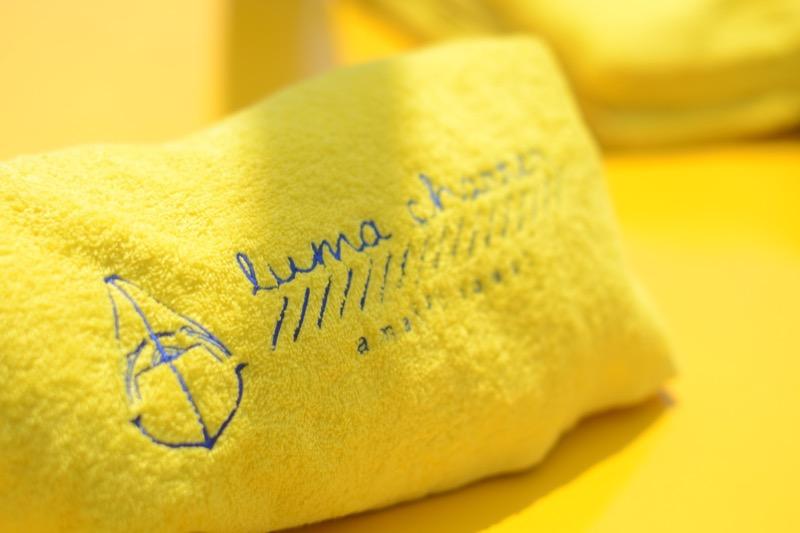 Customized yellow beach towel by Luma Charter