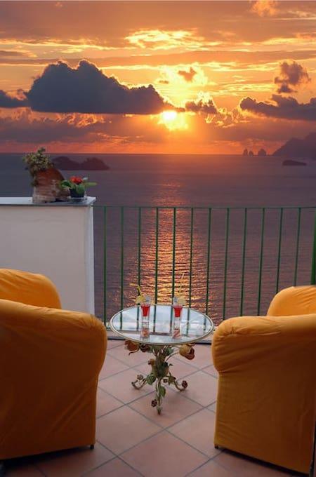 Beautiful sunset on the Amalfi Coast sea view from terrace