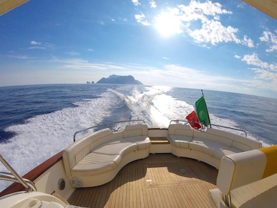 View from boat rear: sea and Island of Capri