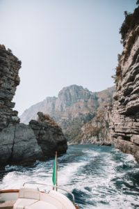 Back waves made by the velocity of a gozzo boat turning through rock caves