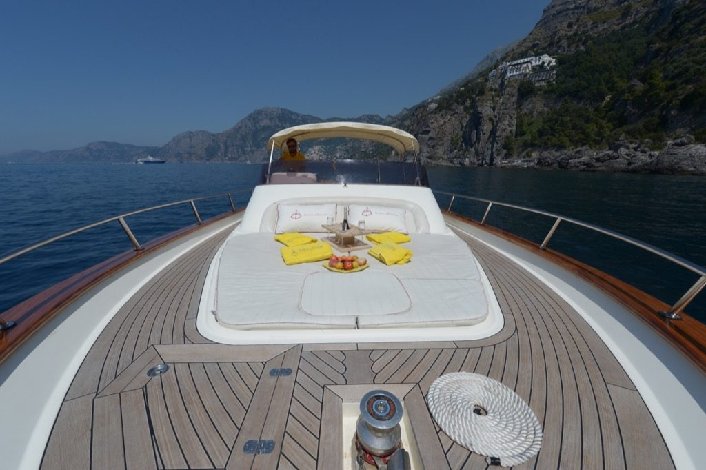 Aperitif on the front of modern gozzo boat Teo
