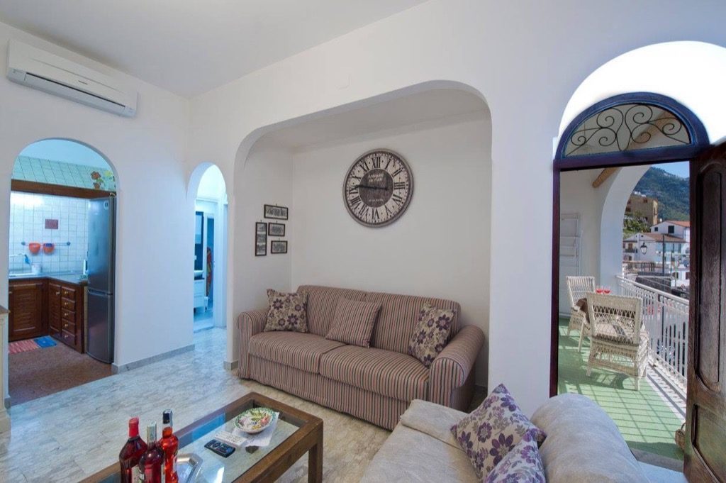Casa Coccinella interior sofa in the living room with access to the terrace