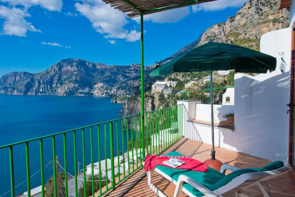 Casa Regina terrace on the sea with a chaise longue