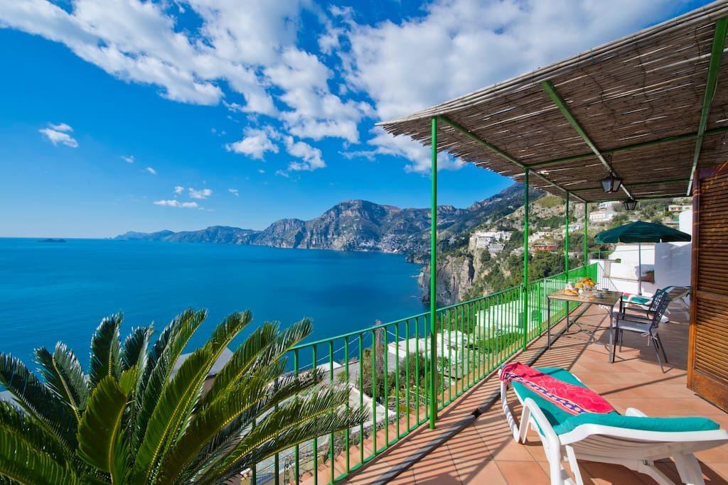 Casa Regina terrace under the sun and on the sea of the Coas