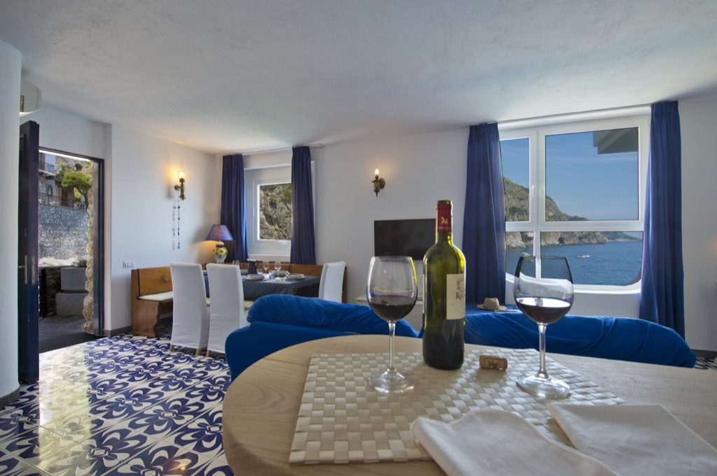 Casa Terramare interior open table with wine and glasses