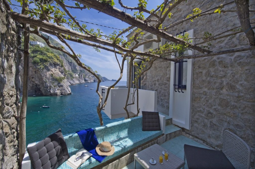 Casa Terramare rear terrace overview with sea and rocks