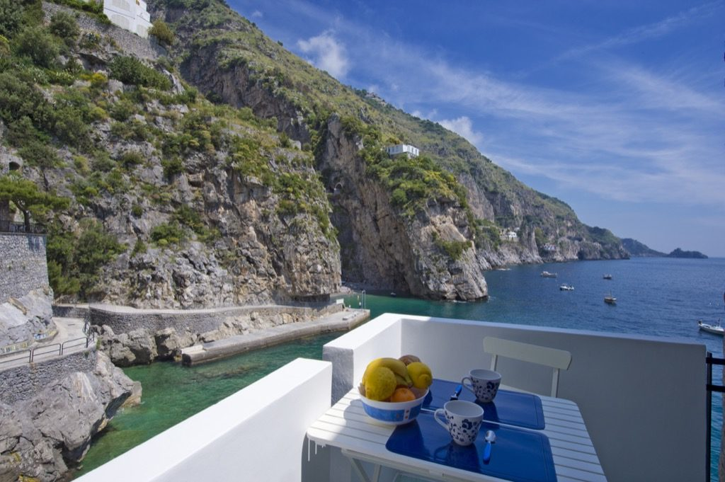 Casa Terramare terrace on sea and coast with table and fruit