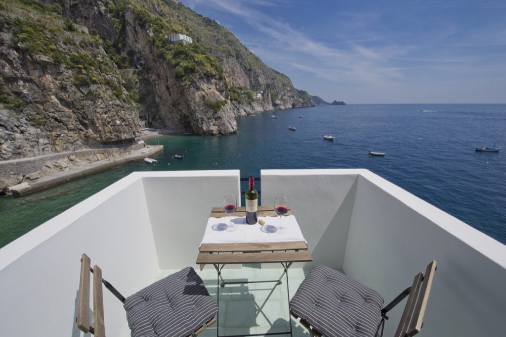 Casa Terramare terrace on sea and coast with wine and glasses on the table
