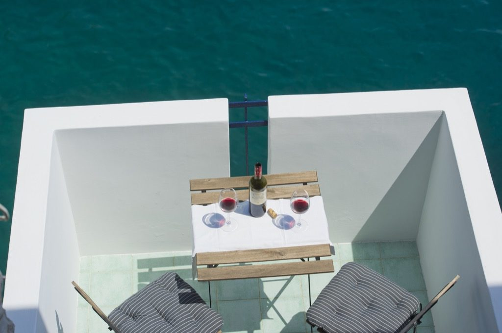 Casa Terramare terrace on the sea with table chairs and wine