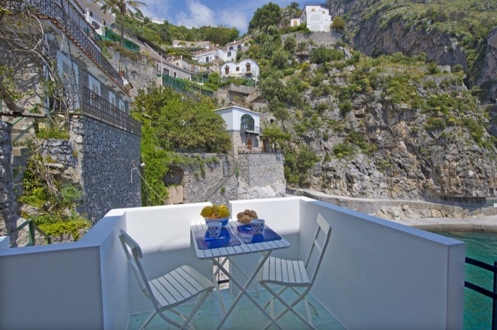 Casa Terramare terrace on the sea with table and fruit