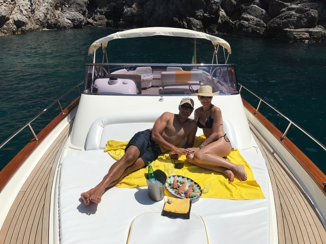 A couple tasting an aperitif onboard the boat
