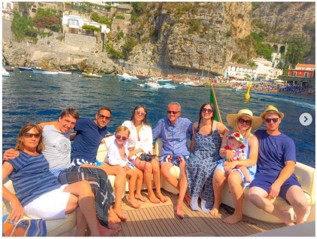 Large group of friends on the boat in the sea of the Coast
