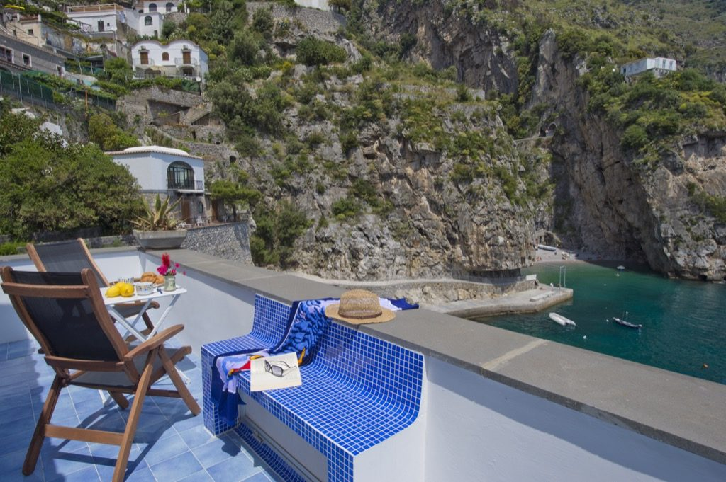 Suite Terramare chairs and view from terrace to the sea and coast under the sun